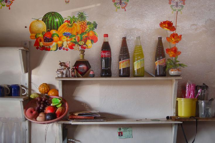 Botellas y fruta by Nancy Goodrich